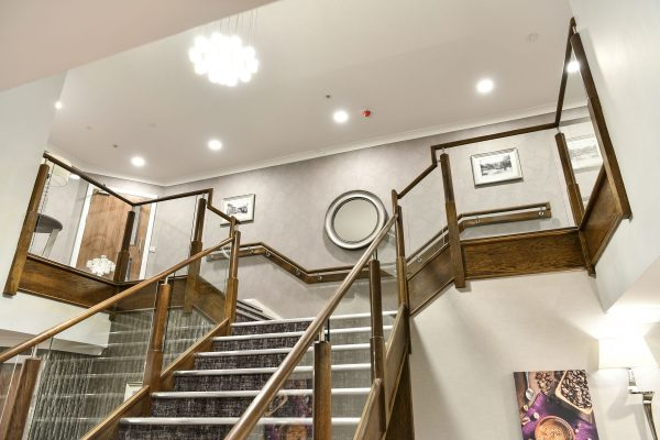 An interior view of the main stairs at Hen Cloud House